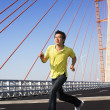 Stock Photo: Young man jog in bridge area
