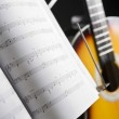 Musical chords and guitar on background — Stock Photo #11057641