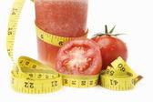 Tomato juice with measuring tape — Stock Photo