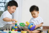 Brothers playing together — Stock Photo
