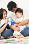 Asian young family spending time together — Stock Photo