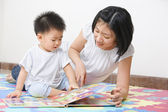Mother tutoring her son — Stock Photo