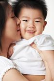 Mother kiss her son — Stock Photo