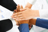 Leader and his employees hands in unity — Stock Photo