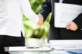 Handshake between businessman and businesswoman — Stock Photo