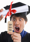 Surprised scholar in expensive education — 图库照片