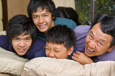 Father and sons having fun in bedroom — Stock Photo