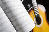 Musical chords and guitar on background — Stock Photo