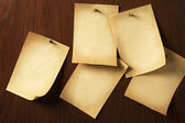 Group of parchments nailed on wooden board — Stock Photo