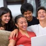 Teenagers watching something on laptop — Stock Photo