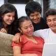 Teenagers watching something on laptop — Stock Photo