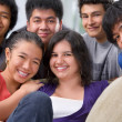 Multi ethnic students pose together — Stockfoto