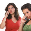 Two female teenagers on the phone — Stock Photo #11063470