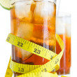 Two glass of soft drinks with tape measure — Stock Photo