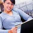 Stock Photo: Using credit card for online transaction