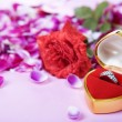 Stock Photo: Ring and rose to propose on valentine day