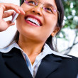 Stock Photo: Businesswomin happily talking on phone