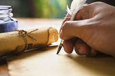 Hand writing using quill pen — Stock Photo