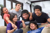 Multi race teenagers pose together — Stockfoto