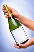 Offering champagne — Stock Photo