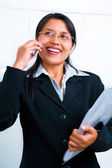 Young businesswoman havs incoming call — Stock Photo