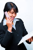 Side view of young businesswoman having dicsussion on phne — Stock Photo