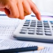 Calculating using calculator — Stock Photo