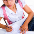 Foto Stock: Female scholar writing mathematics fomula