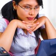 Foto Stock: Female scholar looking at her laptop