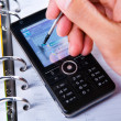Using stylus on touch screen cell phone — Stock Photo #11071375