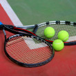 Tennis rackets, balls and court — Stock Photo