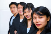 Asian business line up — Stock Photo