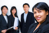 Young Asian Businesswoman smiling to camera with other on — Stock Photo