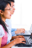 Scholars listening and typing in class — Stock Photo
