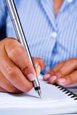 Writing on book using fountain pen — Stock Photo