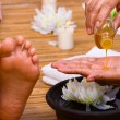 Pouring massage oil — Stock Photo #11080284