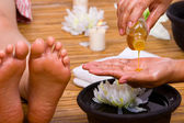 Pouring massage oil — Stock Photo