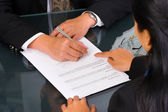 Business woman shows where to sign — Stock Photo
