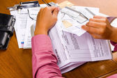 Tearing all the bills — Stock Photo