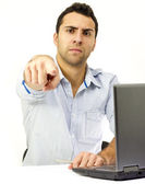Angry boss in front of his laptop — Stock Photo