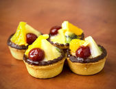 Closeup of four delicious fruit dessert tarts — Stock Photo