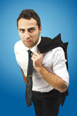 Portrait of a serious businessman holding coat on shoulder — Stock Photo