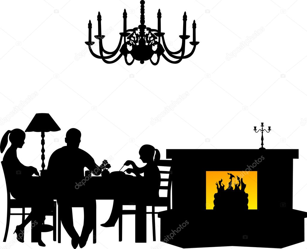 Family having their dinner at the table next to the ...