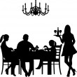Silhouette of a restaurant scene were a family enjoy their dinner while the waiter is serving the wine — Stock Vector