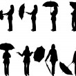 Woman with umbrella in different poses silhouette — Stock Vector