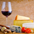 Rustic snack with cheese and wine — Stock Photo