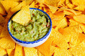 Nacho chips and guacamole — Stock Photo