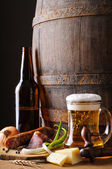Still life with beer and food — Stock Photo