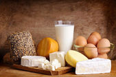 Cheese, bread, milk and eggs — Stock Photo