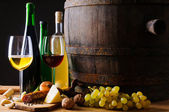 Dinner with wine and traditional food — Stock Photo